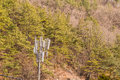 Cellphone tower on the side of a mountain Royalty Free Stock Photo
