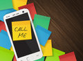 Cellphone and yellow reminder sticker with text call me Royalty Free Stock Photo
