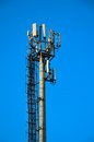 Cellular antenna on a background of blue cloudless sky Stock Images