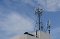 Cellular antenna communication on a building roof top Stock Photo