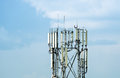 Cellular antenna tower over blue sky Stock Photo