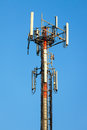 Cellular communication tower on blue sky background Stock Image