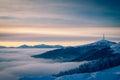 Cellular communications tower on mountain. Sunrise on the horizo Royalty Free Stock Photo