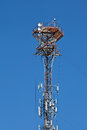 Cellular mobile radio transmission pole tower on the blue sky Royalty Free Stock Photo