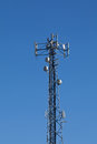 Cellular mobile radio transmission pole tower on the blue sky Stock Photography