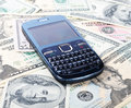 Cellular phone on dollars as a background Royalty Free Stock Photo