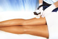 Cellulite treatment legs in cosmetics salon Stock Photos