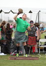Celtic competition and games man hurls boulder at the rio grande valley festival in albuquerque nm Royalty Free Stock Photography
