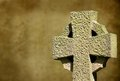 Celtic cross on blurred brown background with copy space Royalty Free Stock Photography
