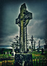 Celtic cross in the rain high covered with moss irish hdr toned Royalty Free Stock Photo