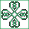 Celtic style endless knot pattern in clover shape with hearts elements in tile, in black and green cross stitch inspired by Iris