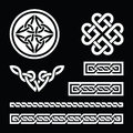 Celtic white knots braids and patterns on black background set od traditional symbols in Stock Photos