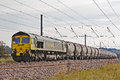 Cement construction flitwick uk september a freightliner diesel loco hauls a heavy goods train of through flitwick on september in Royalty Free Stock Photos