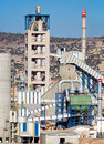 Cement factory machinery on a clear blue day Stock Image