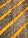Cement floor with yellow stipe Royalty Free Stock Photo