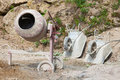 Cement mixer a mixerr and two barrows Royalty Free Stock Photos
