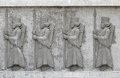 Cement relief achaemenid soldiers on wall Royalty Free Stock Photography