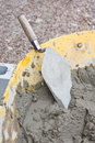 Cement In Wheelbarrow With Trowel Royalty Free Stock Images