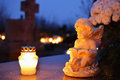 Cemetery angel figurine of an and a burning candle on the gravestone Stock Image