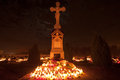 Cemetery cross lit by candle lights during all saints day Stock Images