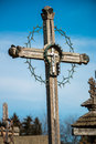 Cemetery cross an ornate with a circle of thorns in a Royalty Free Stock Image