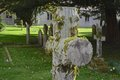 Cemetery cross in a small church yard Stock Photography
