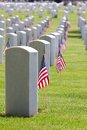 Cemetery memorial day united states american flags decorate the gravestones of veterans at a usa national on Stock Photo