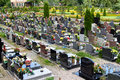 Cemetery in poland rows of monuments with flowers and candles Royalty Free Stock Image