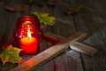 Cemetery red lantern candle with autumn leaves in night Royalty Free Stock Photo