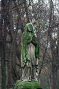 Cemetery sculpture statue of an old woman at powazki warsaw poland – the oldest and most famous in the country the is Royalty Free Stock Photo