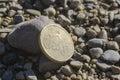 Cent lying on beach Royalty Free Stock Photos