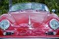 Center front red vintage retro 1958 Porsche 356 Speedster sports motor car Royalty Free Stock Photo