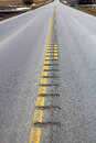 Center line rumble strips down a lonely country road Royalty Free Stock Photo