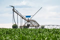 Center Pivot Irrigation System in Cornfield Royalty Free Stock Photo