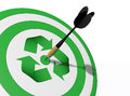 The center is the recycle a closeup of a target with a green symbol in and a perfect shot of a dart in middle of it Royalty Free Stock Photos