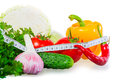 Centimeter and healthy food on a white background Royalty Free Stock Photo