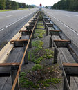 Central barrier at highway with moss and dirt eight lane Stock Images