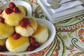 Central European dessert a version of Austrian Germknoedel of steamed sweet dumplings with fruit filling and hot f
