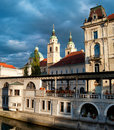 Central market of ljubljana and cathedral with moody sky slovenia Stock Image