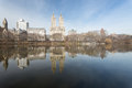 Central park, buildings reflection in a pond Royalty Free Stock Photo