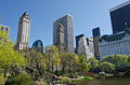 Central Park lake and surrounding buildings Royalty Free Stock Photo
