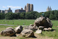 Central park in new york summer time manhattan people reading relaxing and doing sports Royalty Free Stock Images
