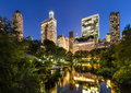 Central Park Pond and Illuminated Manhattan Skyscrapers, New York Royalty Free Stock Photo