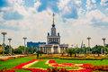 Central pavilion, exhibition center. Beautiful flower beds. ENEA,VDNH,VVC. Moscow, Russia. Royalty Free Stock Photo