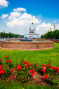 Central pavilion, exhibition center on the blue sky background. Red flowers. Fountain. ENEA,VDNH,VVC. Moscow, Russia. Royalty Free Stock Photo