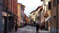 Central street in the center of old small town and comune Iseo in the province of Brescia, Lombardy with walking people Royalty Free Stock Photo