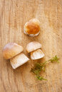 Cep mushrooms on wooden board for cooking kitchen Stock Images