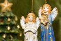 Ceramic angel toys and christmas tree Stock Image