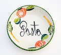 Ceramic bowl with pasta design over white Royalty Free Stock Photo