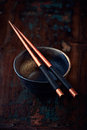 Ceramic bowl and wooden chopsticks Royalty Free Stock Photos
